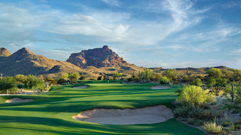 A beautiful, desert golf course at sunset.